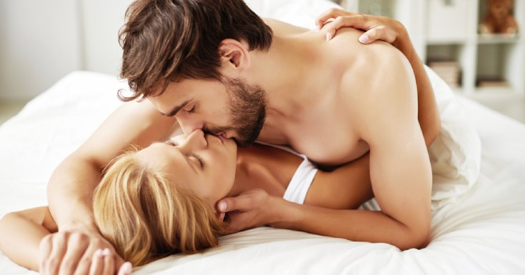 aroused couple kissing each other